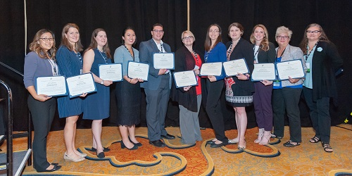 10 Blair Scholars hold their awards at the 2018 ADRP Conference presentation