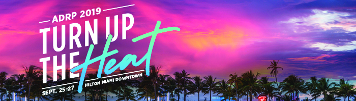 Pink miami skyline with ADRP 2019 conference theme Turn Up the Heat overlay